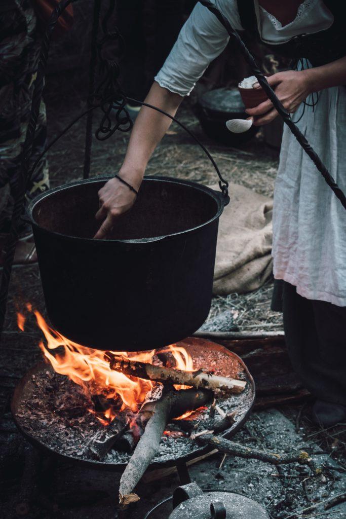 woman cooking on black metal cooking pot